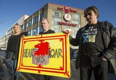 Scottish Resistance activists (left to right) Gwen Sinclair, Sean Clerkin and James Scott protest outside Tunnock's factory in Uddingston. Picture: PA
