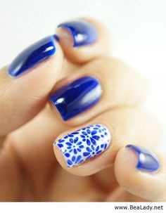 Blue nails with floral print. Reminds me of a gorgeous tea cup