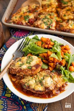 Cheesy Topped Mediterranean Pork Loin Chops - tender pork loin chops in a rich mediterranean style sauce topped with cheese and broiled until melted and golden.Gluten Free, Slimming World and Weight Watchers friendly