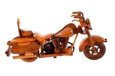 Celebrate the open road with these handcrafted mahogany scale replicas of classic motorcycles including Harley Davidson and the vintage Indian model. Description from premiumwooddesigns.com. I searched for this on bing.com/images