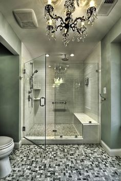 Stunning bathroom chandelier, color scheme, and amazing shower!