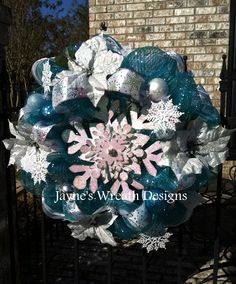 Christmas wreath in blue, white, & silver with Poinsettias and Snowflakes