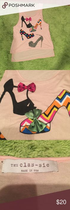 """High low tank High Heel Stilettos Oh so cute. See second picture - the first and second shoes each have an actual bow sewn on making this shirt 2D?  Measures: The front of this top approx 25 1/2"""" from top of shoulder to bottom of hem and about 20"""" across armpit to armpit the back of the shirt measures approx 29"""" from top of shoulder to bottom of hem. There is no tag to show what the material is- it is very soft like a jersey feel and wrinkles - my best guess would be a cotton/poly mix. Made…"""