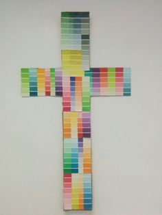 Cross made from paint sample chips. Faux stain glass. Mosaic.  For youth worship room.