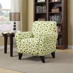 The Portfolio Seth arm chair features a transitional design with flared arms and a shaped back. The Seth chair is covered in an apple green and cream mosaic modern floral fabric.