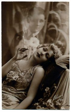 A trope: A woman dreams of a man and imagines him floating and appearing in her cigarette smoke. Damn, that's pretty sexy.