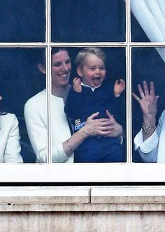 Georgie with his tongue out watching the Trooping the color ceremony! Such a cutie!