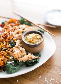 Thai Coconut Salad with Peanut Sauce - fresh greens, roasted red peppers, sweet potatoes and shredded coconut, all drizzled with a warm peanut sauce.