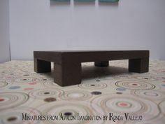 1:12 scale chocolate brown  modern dollhouse coffee table. $8.50, via Etsy.