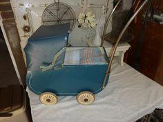 nolstalgische poppenwagen storck blauw