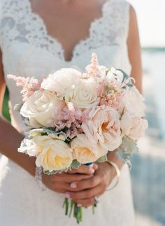 blush pink and cream bouquet + lace wedding dress