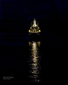 Ship At Night - Ship's  Golden Reflexions in the Mediterranean Sea  at Night.