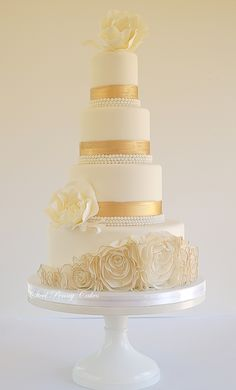 Rosette ruffles, brushed gold bands, and oversized peony roses wedding cake by Elysia  Smith, Steel Penny Cakes