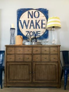 Summer Home Tour: It's a Shore Thing at the Lake. A NO WAKE ZONE wooden sign and nautical inspired barware create the perfect cottage look. Create your own Summer cocktail bar area with nautical accessories at HomeGoods. Sponsored Post