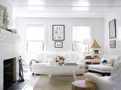 An all-white room that manages to be warm...{See article for advice on decorating with white from Shabby Chic's Rachel Ashwell}
