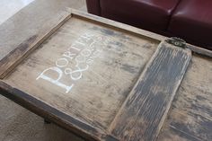 family sign painted on using a vinyl template (old door turned coffee table)