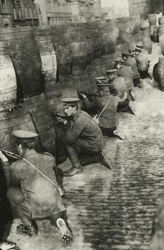 British troops behind a barricade of empty beer casks, near the quays in Dublin during the Easter Rising, 1916