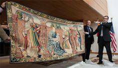 ICE Director John Morton holds returned tapestry, Spanish Ambassador Ramón Gil-Casares behind him