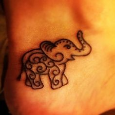 Elephant tattoo... Elephants are extremely protective of their young and members of their herd. This offers symbolism to people getting tattoos who place the value of their families above everything else. Elephants will die to protect their family....