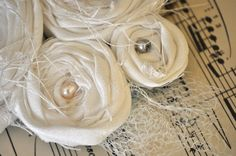 Fabric Rosettes...Bet these would look cute made from T-shirt material.