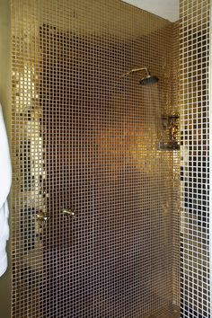 This gold mosaic shower is just over the top glam!- http://www.perfecthideaways.co.za/Details/ABC #luxury #interiordesign #ideas