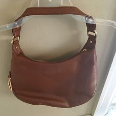 Ralph Lauren brown leather handbag. Ralph Lauren handbag, brown with gold accents. Some wear, reflective on the price. Lining has some wear as well but beautiful Spring/Summer bag. Ralph Lauren Other