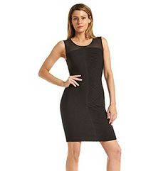 Dresses. Simple and a little sheer, this Calvin Klein dress features allover ribbed details and mesh shoulders. Wear it to your next event to really turn heads. Featured in black Scoopneck Sleeveless Mesh shoulders Allover ribbed design Keyhole at the back Hits above the knee Hidden back zipper Unlined Polyester/spandex Imported