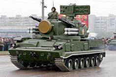 """The 2K22 Tunguska (SA-19""""Grison"""" ) is a Russian tracked self-propelled anti-aircraft weapon armed with a surface-to-air gun and missile system. It is designed to provide day and night protection for infantry and tank regiments against low-flying aircraft, helicopters, and cruise missiles in all weather conditions. to improve on the observed shortcomings of the ZSU-23-4 (short range and no early warning) and a counter to new ground attack aircraft in development, such as the A-10 Thunderbolt…"""