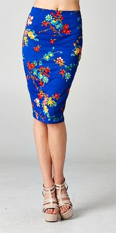 Amp up your wardrobe with this back to basics pencil skirt. This floral royal blue skirt is elegant and at the same time adds color to your outfit.