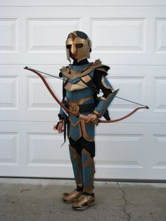 https://flic.kr/p/dq8xZW   Archery Knight   Kids category. The costume is home-made, from the bow & arrows, the quiver, to the armor. About 50% is constructed of cardboard, with the other 50% made of embossed felt, art foam and a lot of hot glue and paint.