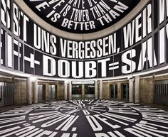 """Barbara Kruger: Circus, 2010. The installation covered the rotunda of the Schirn Kunsthalle in Frankfurt. Kruger works with pictures and words from the media because, she says, they have the ability to tell us who we are and who we aren't. A selection from Circus: """"GEWALT LÄSST UNS VERGESSEN, WER WIR SIND"""" (translation: violence makes us forget who we are)."""