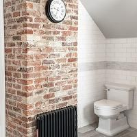 Brick chimney in bathroom.