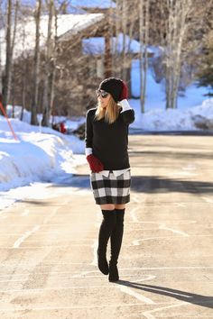 black and white buffalo checked winter skirt with over the knee black boots...love it!