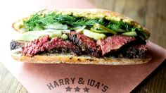 The tangy pastrami sandwich at Harry & Ida's is served with slaw on a roll (Credit: Credit: Erin & Erica)