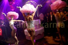 Burlesque Dancers performing at a corporate birthday party by popping out of this giant tiered birthday cake and then performing traditional Burlesque for the guests. Tel: 020 3602 9540   UK ENTERTAINMENT AGENCY spreading Burlesque excitement across the UK inc MANCHESTER, LEEDS, BIRMINGHAM, BRISTOL, BRIGHTON & LONDON  http://www.calmerkarma.org.uk/burlesque-themed-corporate-entertainment.htm