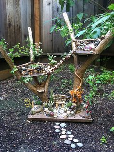 Fairy Tree House....I like the use of the y-shaped branches for the tree houses...