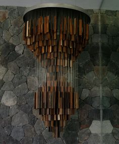 Eva Menz travelled to Bali, Indonesia in 2003 to lead a workshop bringing together aspiring designers and local craftsmen. Supported by live project, the opening of the Gallery at the Sentosa Hotel and Resort in Seminiak, the workshop created the 'Ghost Wood' chandelier. Wooden slabs, off-cuts from the furniture industry, create this contemporary piece that is fully adapted to the local climate.