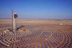 The Khi Solar One Power Plant  It is quite safe to say – without upsetting too many people – that the Northern Cape does not have very much to boast about. It's a place of vast open spaces and blistering sunshine that mainly appeals to hardy souls and adventurers. Yet those characteristics have now turned into its biggest industrial attraction, because open spaces and sunshine are exactly what a solar power plant needs. To Boast, Plant Needs, Vacation Spots, Cn Tower, Solar Panels, Solar Power, Sunshine, Open Spaces, Adventure