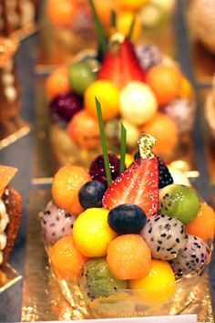 Meticulous fruit pastry arrangement at the Parisian Cafe Pouchkine. What is the white and black-flecked fruit?
