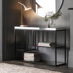 Plush Black Console Table  Creat a focal point with this stylish yet practical designer console table, featuring a bevelled mirror top and tempered mirrored shelves set into a modern, matt black metal frame.