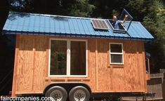 Kirsten Takes You to Molecule Tiny Homes and Interviews Jason Dietz (Video) - nice features - opening skylight, drop down deck and escape door through shower and tiny sink (RV sink) in bathroom