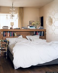 A bookcase as a headboard can help make a small bedroom feel much bigger