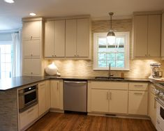 Here the plywood cabinets are simply painted white with extra large hardware added to the lower cabinets. I like it. also like the backsplash and floor, and use of stainless steel with touches of black.