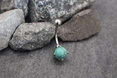 Product Information - Product Type: Curved Barbell in 316L Surgical Stainless Steel - Gauge Size: 14 Gauge (1.6mm) Total Length from Top of Bar to Bottom of Charm: 22mm Precious Turquoise Pronged Bell