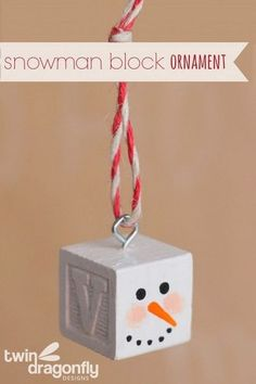 Snowman Block Ornament: The cutest Snowman Block Ornament for this Christmas season! All you need is an alphabet block, acrylic paint, a screw eye and some bakers twine. Super easy and fun to make in several steps! Snowman Christmas Decorations, Christmas Ornaments To Make, Snowman Crafts, Homemade Christmas, Christmas Snowman, Christmas Projects, Kids Christmas, Holiday Crafts, Snowman Ornaments