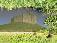 The Keep reflected in its moat