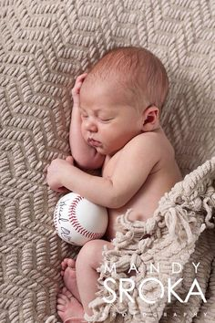 Atlanta Braves newborn. Baby boy with signed Hank Aaron baseball.