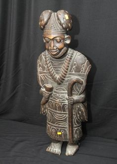 "African art statue of man holding cane, detailed carved decoration, approx 33""T. African Art Auction ending 5/29/13"