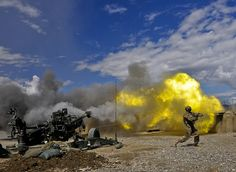Pfc. Erik Park from San Mateo, Calif., fires his M-777 155mm howitzer. Park, who is in 3rd Platoon, Alpha Battery, 1st Battalion, 77th Field Artillery Regiment, 172nd Infantry Brigade, is the number one man on the five-man numbered team that operates the massive weapon system. He was 12 years old on 911.