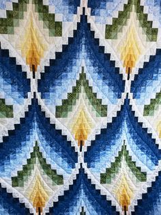 This queen size beauty in shades of blue, yellow and green is hand quilted by a local Mennonite woman.